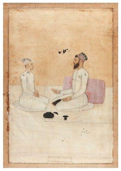 Raja recevant un jeune prince sur une terrasse....