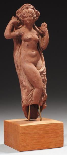 Statuette représentant Vénus anadyomène....