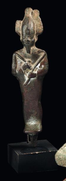Statuette votive représentant le dieu Osiris....