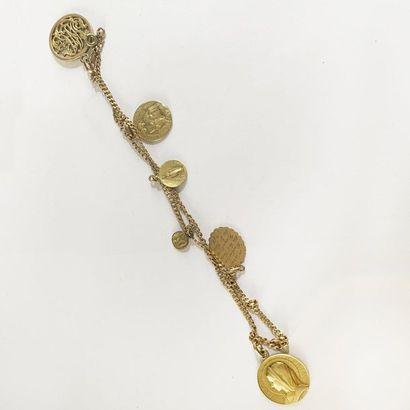 Bracelet en or jaune 18K (750) orné de six...
