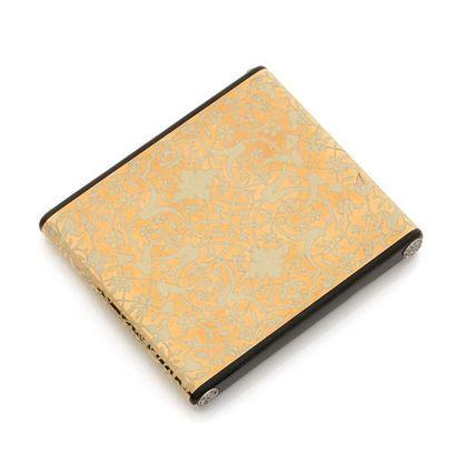 CARTIER. ÉTUI À CIGARETTES en or jaune 18K (750) à décor d'inspiration persanne émaillé...