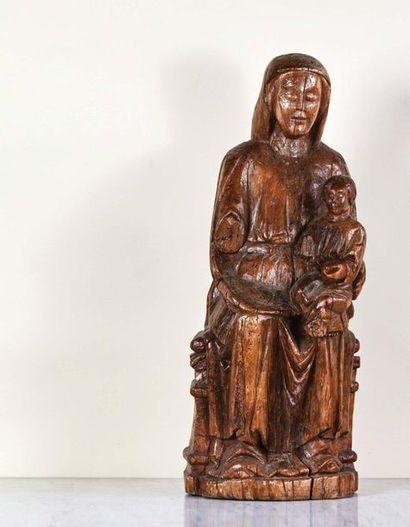 Vierge à l'Enfant en bois sculpté, dos creusé....