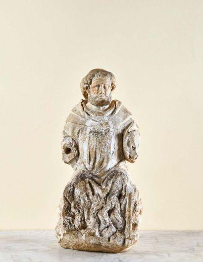 Saint Antoine en pierre calcaire sculptée en ronde-bosse. Assis sur un brasier,...