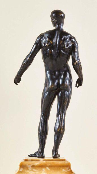 Ecorché en bronze à patine noire. Debout...