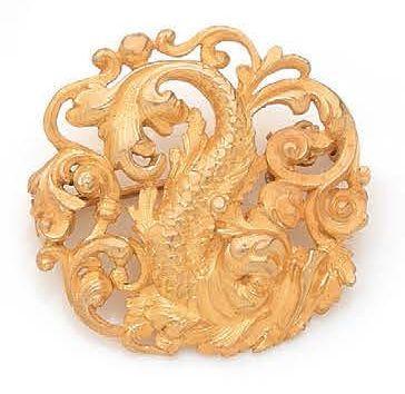 BROCHE RONDE en or jaune 18K (750) ciselée...