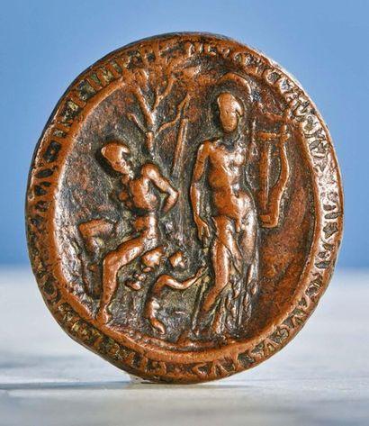 PLAQUETTE ovale en bronze à patine brune...