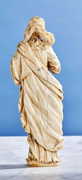 Virgin of Calvary in ivory carved in the round. The Virgin crosses her hands in...
