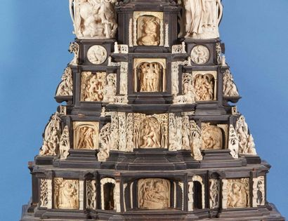 Large stepped altarpiece in blackened wood and carved ivory surmounted by a crucifix....