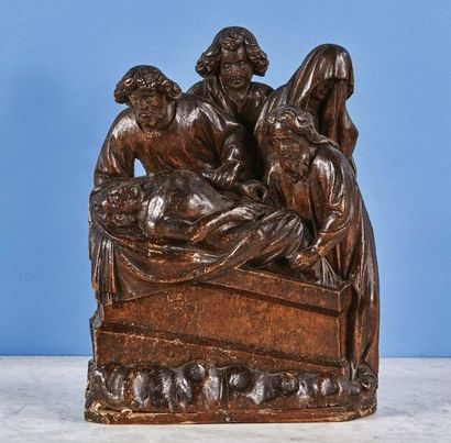 La Mise au Tombeau en noyer sculpté en haut-relief....
