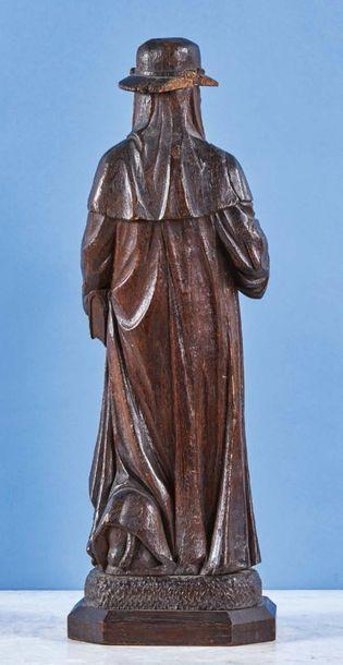 Saint Jérôme en chêne sculpté en ronde-bosse. Coiffé du chapeau cardinaliste, le...