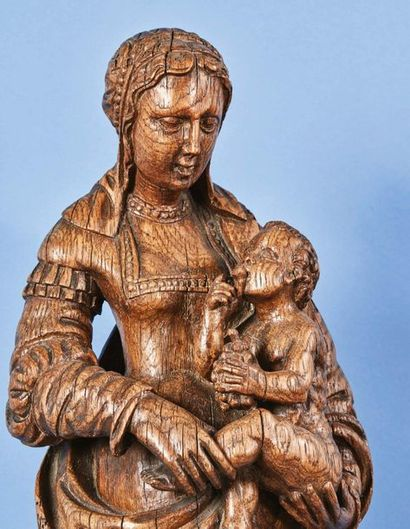 Vierge à l'Enfant au raisin en chêne sculpté...