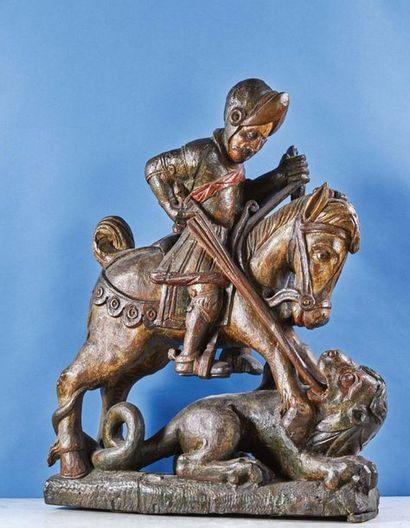 Saint Georges terrassant le dragon en chêne sculpté en ronde-bosse et polychromé....