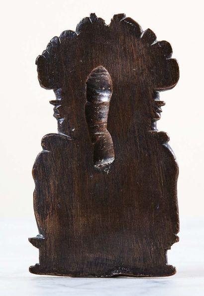 Plaquette en bronze à patine brune avec petits restes de dorure représentant la...