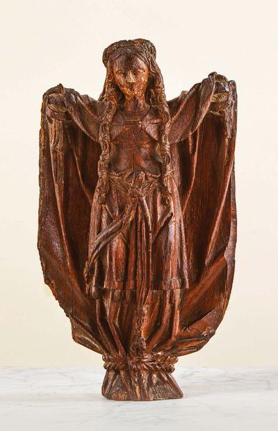 Sainte Wilgeforte en chêne sculpté avec infimes traces de polychromie. La sainte...