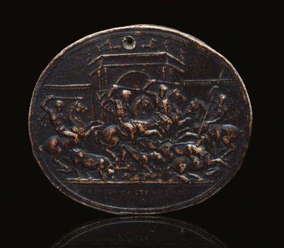 Plaquette ovale en bronze à patine noire représentant une scène de chasse aux taureaux...