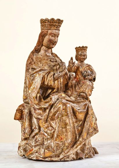 Virgin and Child in wood carved in the round with remains of gilding and polychromy....