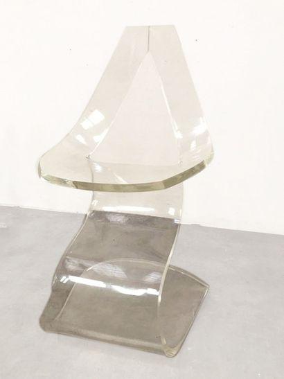 """MICHEL DUMAS (XXe siècle) Suite de quatre chaises modèle """"Lucite"""" Plexiglass thermoformé..."""