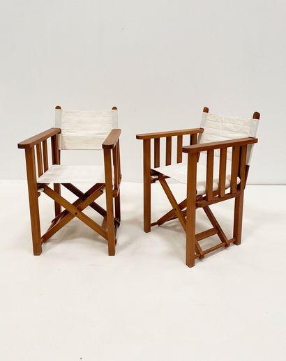 Paire de fauteuils de producteurs En palissandre...