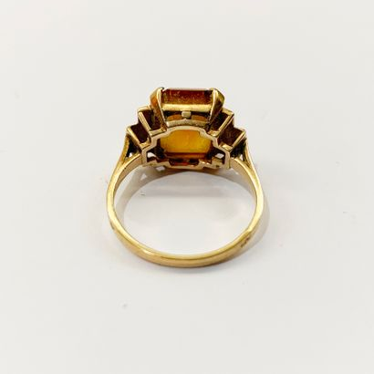 An 18K (750) yellow gold ring with a rectangular citrine. French work. TDD: 52.5...