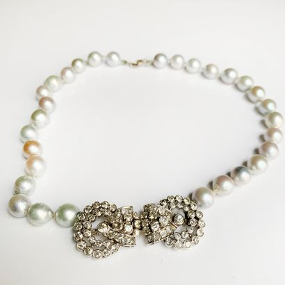 Necklace of one row of silver baroque pearls, the central motif in 18K (750) white...