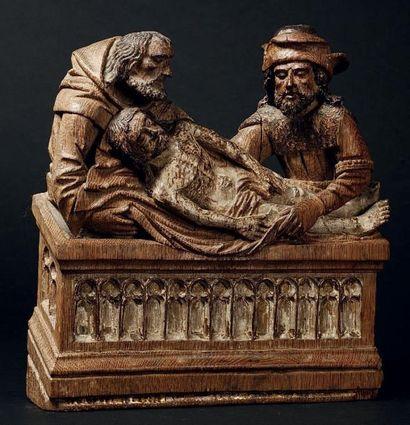 MISE AU TOMBEAU en chêne sculpté en applique...