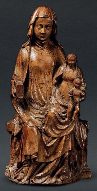 BELLE SAINTE ANNE TRINITAIRE en noyer sculpté...