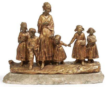FÊTE AU VILLAGE, groupe en bronze doré représentant...
