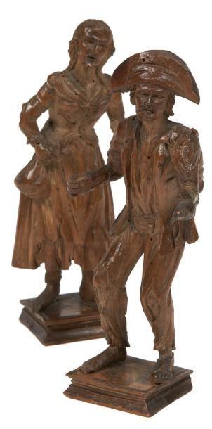DEUX STATUETTES en bois naturel sculpté figurant...