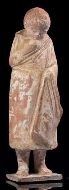 STATUETTE DE GARÇON. Statuette représentant...