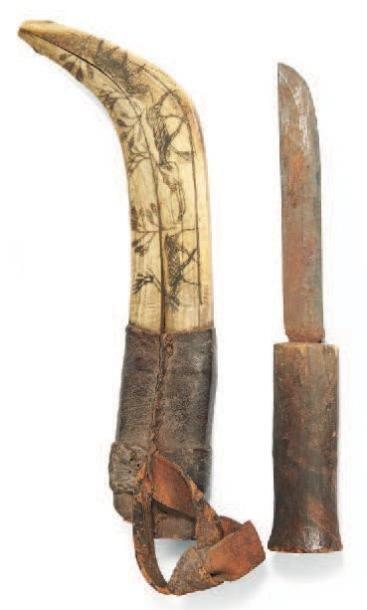 COUTEAU à manche en bois et lame de métal....