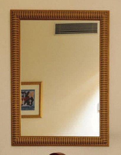 Miroir à godrons en bois doré. H_80 cm L_59...