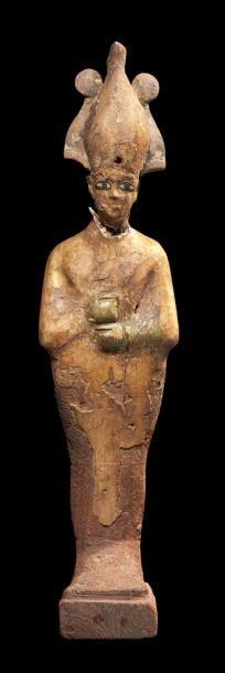 STATUETTE D'OSIRIS. Grande statuette représentant...