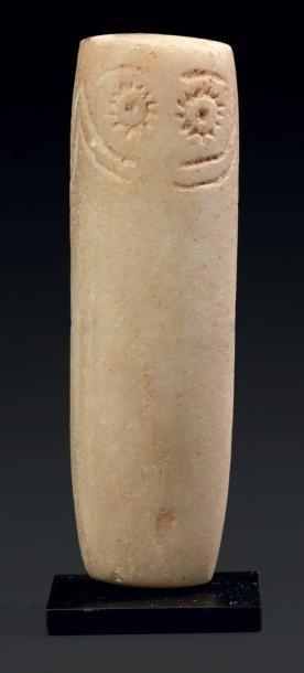 IDOLE IBÉRIQUE. Idole à corps cylindrique,...