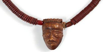 ANCIEN PENDENTIF «IKHOKO» en os sculpté d'un...