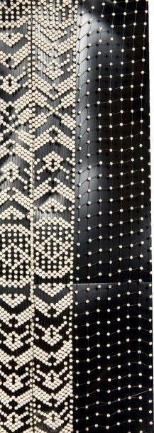 JEAN PATOU, circa 1930/35 VESTE DU SOIR en résille noire rehaussée de strass et bordée...