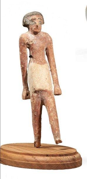 STATUETTE MASCULINE. Statuette provenant d'un modèle, représentant un homme marchant,...