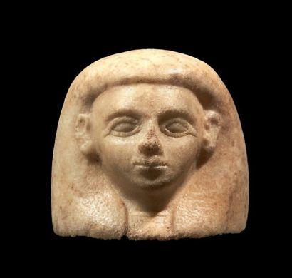 BOUCHON DE VASE CANOPE. Bouche représentant la tête d'un des quatre fils d'Horus...