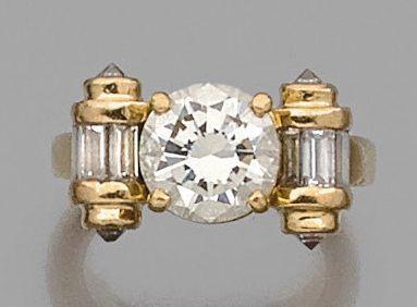 BAGUE en or jaune 18K, ornée d'un diamant...