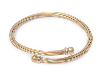 Bracelet jonc torsadé en trois tons d'or...