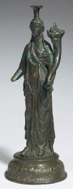 STATUETTE DE FORTUNA. Statuette représentant...