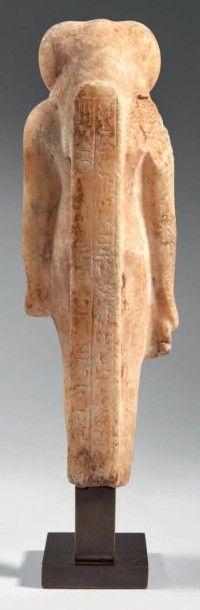 STATUETTE DE THOT. Rare statuette représentant le dieu Thot. Il est debout, dans...