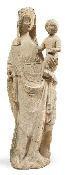 VIERGE À L'ENFANT en pierre calcaire sculptée,...