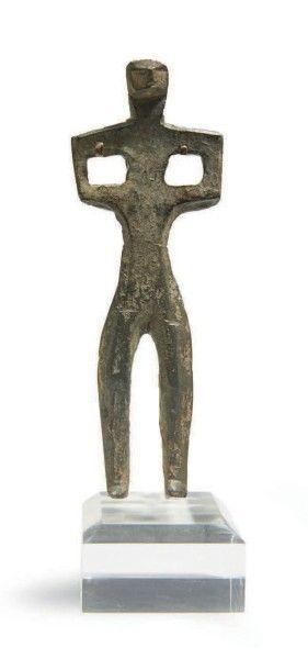 STATUETTE MASCULINE. Statuette votive représentant...