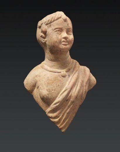 BUSTE DE JEUNE GARÇON. Figurine représentant...