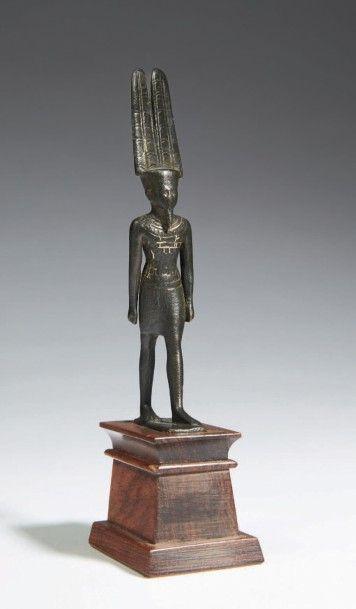 STATUETTE D'AMON. Statuette votive représentant...