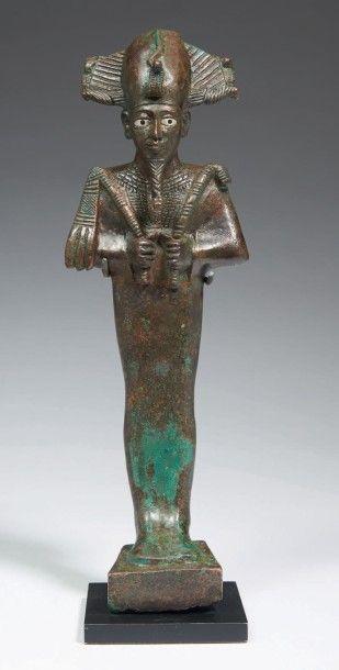 STATUETTE D'OSIRIS DÉDIÉE PAR IMEN-BAOU. Grande statuette votive représentant le...