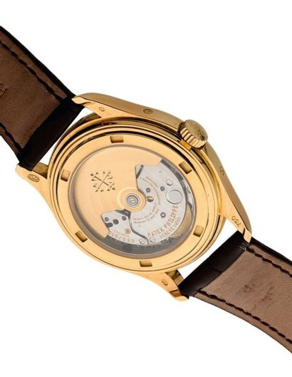 PATEK PHILIPPE QUANTIEME ANNUEL N°3066568 Belle montre bracelet en or rose 18k (750)....