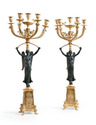 Paire de candélabres à cinq branches en bronze...