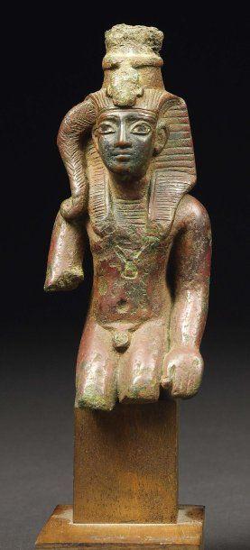 Statuette votive représentant le dieu Harpocrate....