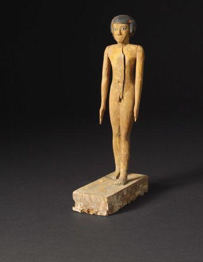 Statuette représentant un jeune garçon nu,...